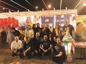 لقطة جماعية للمشاركين في الاحتفال بالقرقيعان